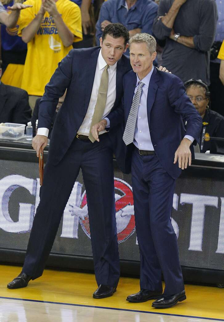 Golden State Warriors' assistant coach Luke Walton and Coach Steve Kerr confer in the first quarter during Game 7 of the NBA Finals at Oracle Arena on Sunday, June 19, 2016 in Oakland, Calif.