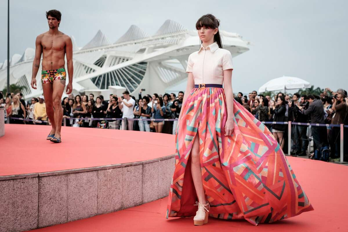Models walk around a monument at Maua Plaza in the closing event of the first edition of Rio Moda Rio in Rio de Janeiro, Brazil, on June 18, 2016.