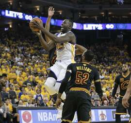 Golden State Warriors' Draymond Green goes up for a layup in the second quarter during Game 7 of the NBA Finals at Oracle Arena on Sunday, June 19, 2016 in Oakland, Calif.