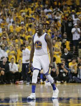 Golden State Warriors' Draymond Green reacts in the second quarter during Game 7 of the NBA Finals at Oracle Arena on Sunday, June 19, 2016 in Oakland, Calif.