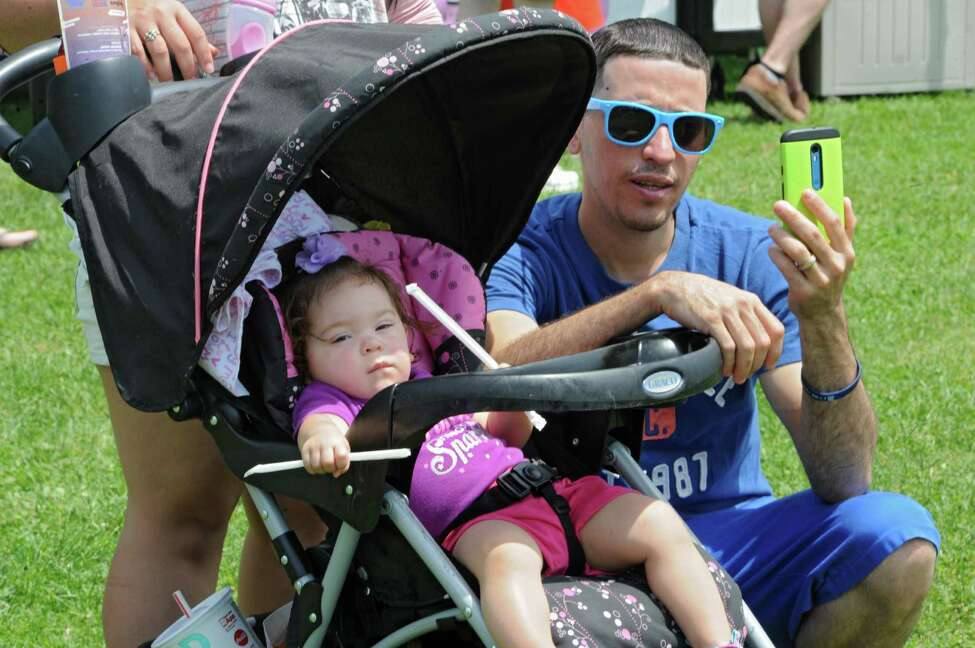 Randy Rivera of Albany takes a selfie with his daughter Kemyliz, 1, during Dad Fest in Washington Park on Sunday, June 19, 2016 in Albany, N.Y. (Lori Van Buren / Times Union)