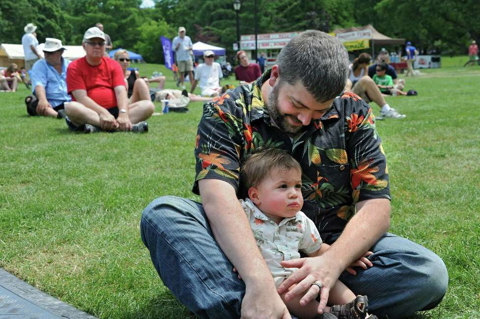 Chuck and his son Charlie of Latham listen to the music of Bondville Boys during Dad Fest in Washington Park on Sunday, June 19, 2016 in Albany, N.Y. (Lori Van Buren / Times Union)