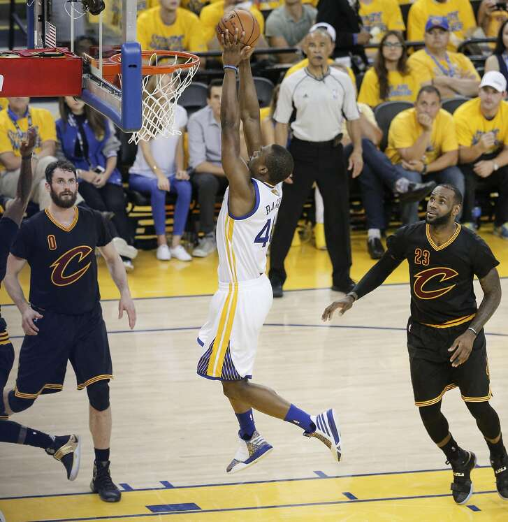 Golden State Warriors' Harrison Barnes goes up for a dunk in the third quarter during Game 7 of the NBA Finals at Oracle Arena on Sunday, June 19, 2016 in Oakland, Calif.