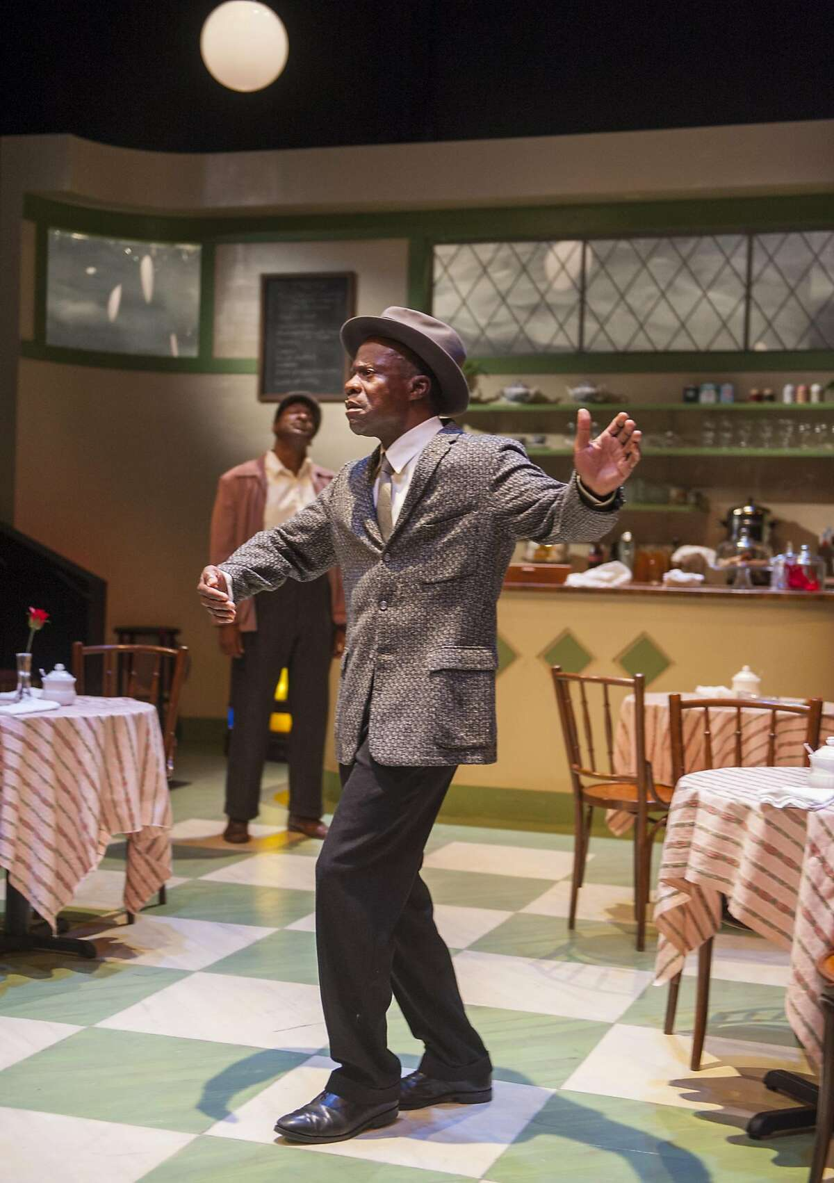 Willie (Adrian Roberts, left) and Sam (L. Peter Callender) end a difficult day with a dance.