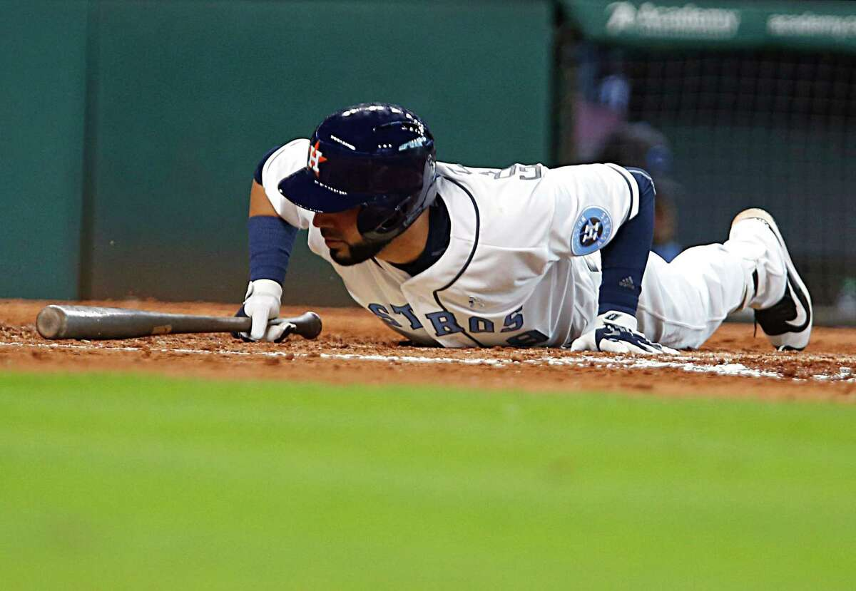 Astros first baseman Marwin Gonzalez hits the deck to avoid being hit by a pitch from Reds starter Brandon Finnegan in the fifth inning Sunday.