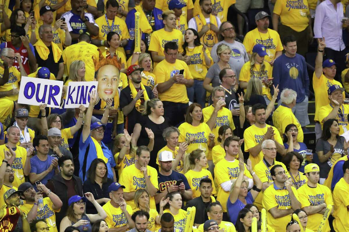 OAKLAND, CA - JUNE 19: Fans cheer in Game 7 of the 2016 NBA Finals between the Cleveland Cavaliers and the Golden State Warriors at ORACLE Arena on June 19, 2016 in Oakland, California. NOTE TO USER: User expressly acknowledges and agrees that, by downloading and or using this photograph, User is consenting to the terms and conditions of the Getty Images License Agreement.