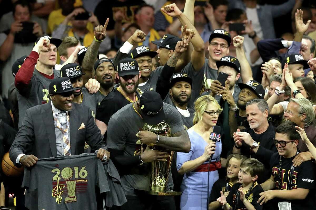 OAKLAND, CA - JUNE 19: LeBron James #23 of the Cleveland Cavaliers holds the Larry O'Brien Championship Trophy after defeating the Golden State Warriors 93-89 in Game 7 of the 2016 NBA Finals at ORACLE Arena on June 19, 2016 in Oakland, California. NOTE TO USER: User expressly acknowledges and agrees that, by downloading and or using this photograph, User is consenting to the terms and conditions of the Getty Images License Agreement.