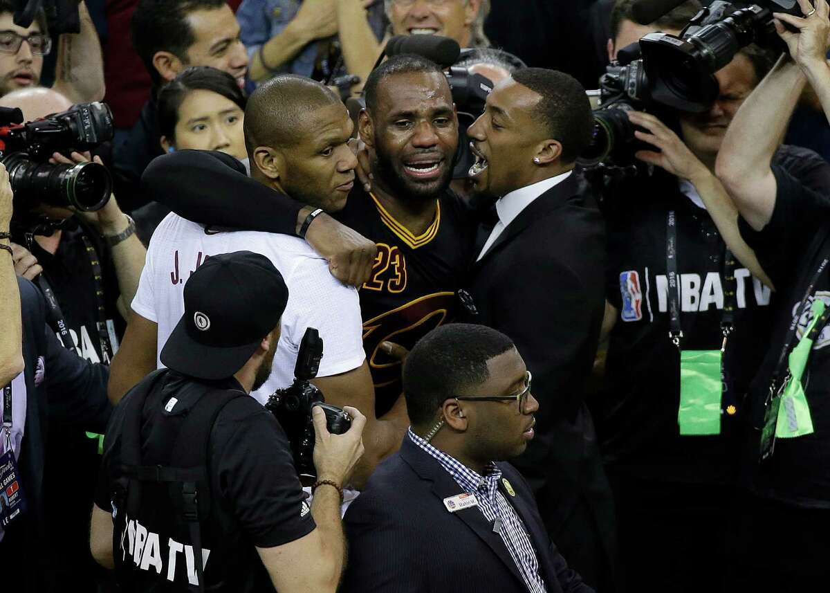Cleveland Cavaliers forward LeBron James, center, celebrates after Game 7 of basketball's NBA Finals between the Golden State Warriors and the Cavaliers in Oakland, Calif., Sunday, June 19, 2016. The Cavaliers won 93-89. (AP Photo/Eric Risberg)