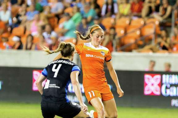 Houston Dash forward Janine Beckie (11) prepares to kick the ball in front of FC Kansas City defender Becky Sauerbrunn (4) during the second half of action between the Houston Dash and the FC Kansas City during a soccer game at BBVA Compass, Sunday, June 19, 2016, in Houston. FC Kansas City defeated Houston Dash 1-0. ( Juan DeLeon / for the Houston Chronicle )