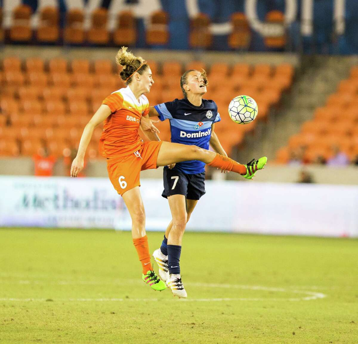 Houston Dash midfielder Morgan Brian (6) kicks the ball in front of FC Kansas City midfielder Mandy Laddish (7) during the second half of action between the Houston Dash and the FC Kansas City during a soccer game at BBVA Compass, Sunday, June 19, 2016, in Houston. FC Kansas City defeated Houston Dash 1-0. ( Juan DeLeon / for the Houston Chronicle )