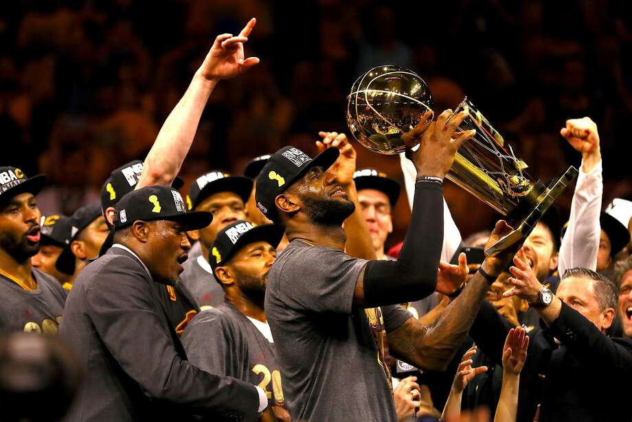 OAKLAND, CA - JUNE 19: LeBron James #23 of the Cleveland Cavaliers holds the Larry O'Brien Championship Trophy after defeating the Golden State Warriors 93-89 in Game 7 of the 2016 NBA Finals at ORACLE Arena on June 19, 2016 in Oakland, California. NOTE TO USER: User expressly acknowledges and agrees that, by downloading and or using this photograph, User is consenting to the terms and conditions of the Getty Images License Agreement. (Photo by Ezra Shaw/Getty Images) Photo: Ezra Shaw, Getty Images