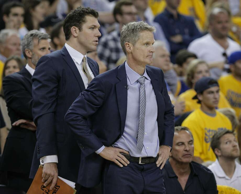 Golden State Warriors' Coach Steve Kerr and assistant coach Luke Walton watch the fourth quarter during Game 7 of the NBA Finals at Oracle Arena on Sunday, June 19, 2016 in Oakland, Calif. The Cleveland Cavaliers defeated the Golden State Warriors 93 to 89 to win the NBA Championship. Photo: Carlos Avila Gonzalez, The Chronicle