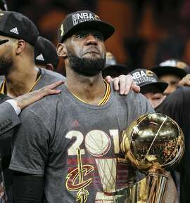 Cleveland Cavaliers' LeBron James holds the the Larry O�Brien NBA Championship Trophy after defeating Golden State Warriors 93 to 89 in Game 7 of the NBA Finals at Oracle Arena on Sunday, June 19, 2016 in Oakland, Calif.