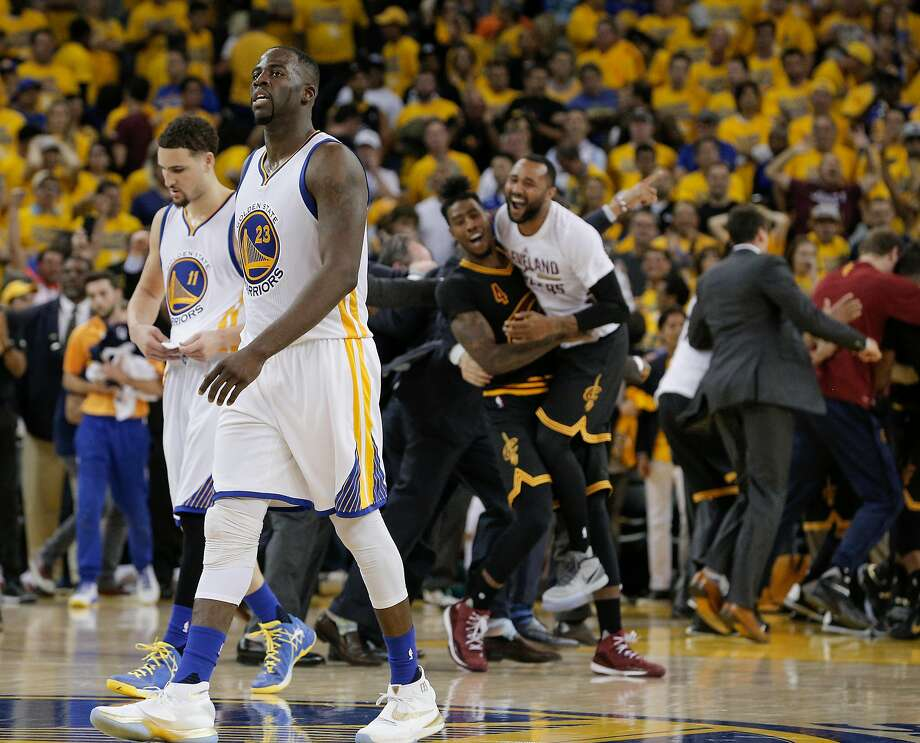 Golden State Warriors' Klay Thompson and Draymond Green walk off the court after the Cleveland Cavaliers won the NBA Championship in Game 7 of the NBA Finals at Oracle Arena on Sunday, June 19, 2016 in Oakland, Calif. Photo: Carlos Avila Gonzalez, The Chronicle