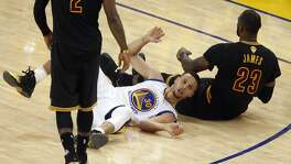 Golden State Warriors' Stephen Curry reacts to fouling Cleveland Cavaliers' LeBron James late in the 4th quarter of Cleveland's 93-89 win in Game 7 of the NBA Finals at Oracle Arena in Oakland, Calif., on Sunday, June 19, 2016.