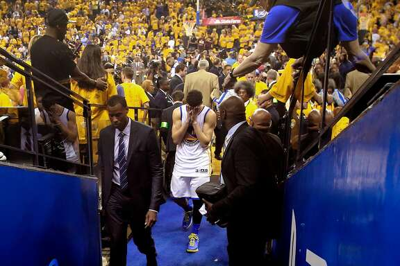 Warriors' KLay Thompson heads to the locker room after the Golden State Warriors lost to the the Cleveland Cavaliers 93-89 in game 7 of the NBA Championship at Oracle Arena in Oakland, California on Sun. June 19, 2016.
