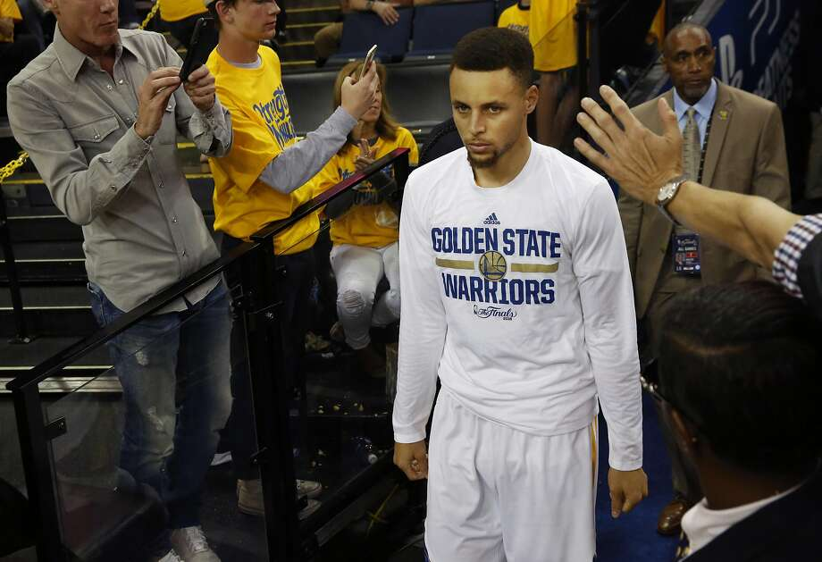 Steph Curry walks out onto the court for the second half during game 7 of the NBA Finals featuring the Warriors and the Cavaliers at the Oracle Arena June 19, 2016 in Oakland, Calif. Photo: Leah Millis, The Chronicle