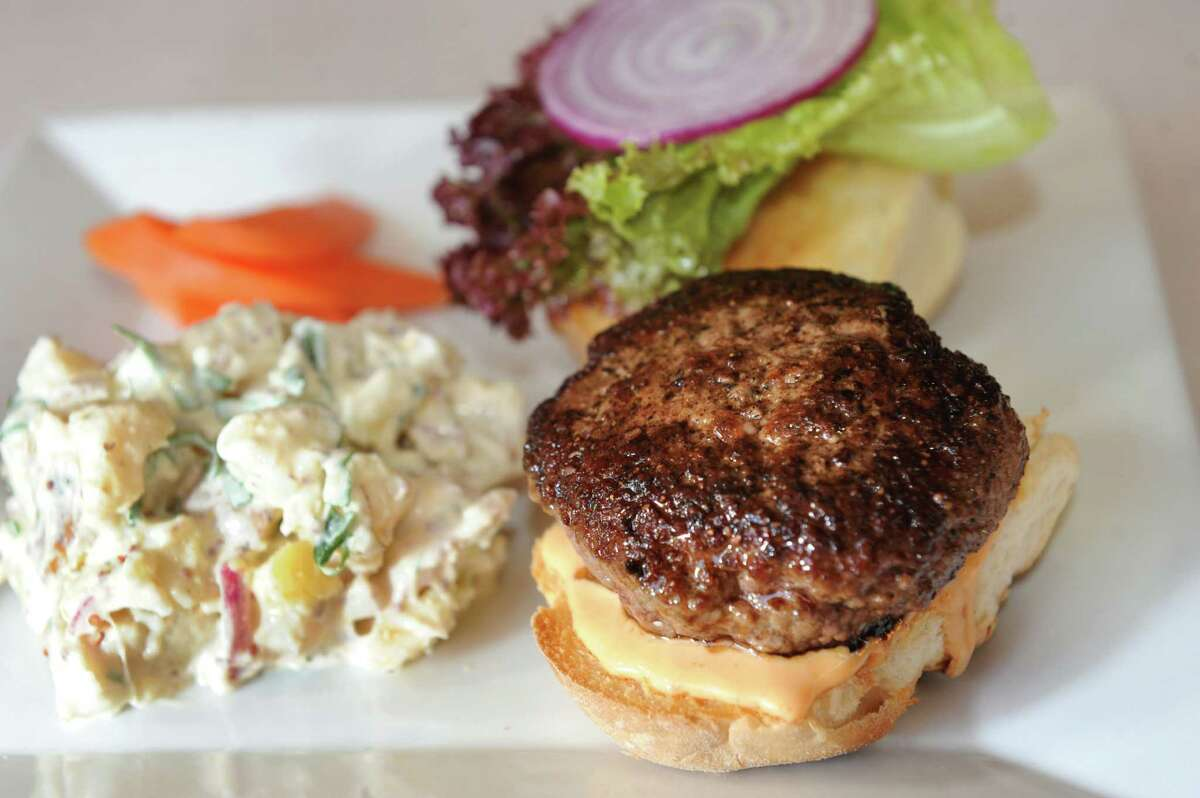 Sweet Beet Bistro , 93 Main St., Greenwich. Phone: 692-0200. Web:sweetbeetbistro.com.Overall rating: ***1/2.Read review on tu+. Grass Fed Burger with cheddar, lettuce, red onion and zesty mayo and served with potato salad and homemade pickles at Sweet Beet Bistro in Greenwich. (Cindy Schultz / Times Union)