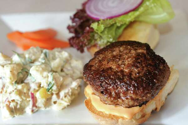 Grass Fed Burger with cheddar, lettuce, red onion and zesty mayo and served with potato salad and homemade pickles at Sweet Beet Bistro in Greenwich. (Cindy Schultz / Times Union)