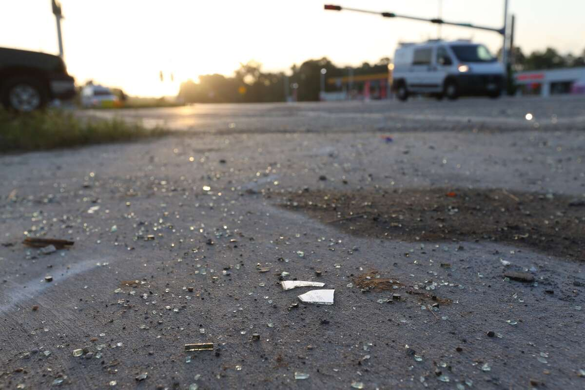 Broken glass remains Monday, June 20, 2016, at FM 1485 and Texas 242 where a police officer and 11-year-old child were killed during a police chase the night before, according to news reports. (Elizabeth Conley / Houston Chronicle)