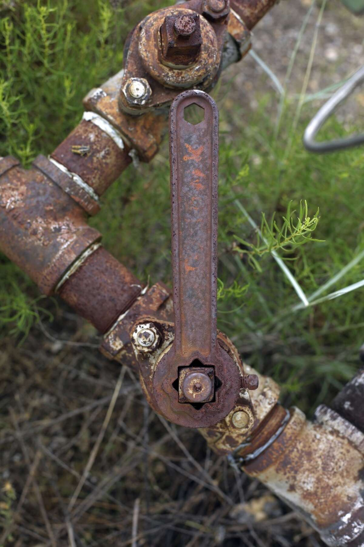 Abandoned oil equipment. (AP Photo/Eric Gay)