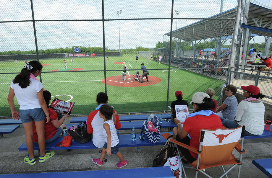 Family members watch their sons play during the Nationals Baseball Tournament at Ford Park on Monday. Photo taken Monday, July 21. 2104 Guiseppe Barranco/@spotnewsshooter Photo: Guiseppe Barranco, Photo Editor