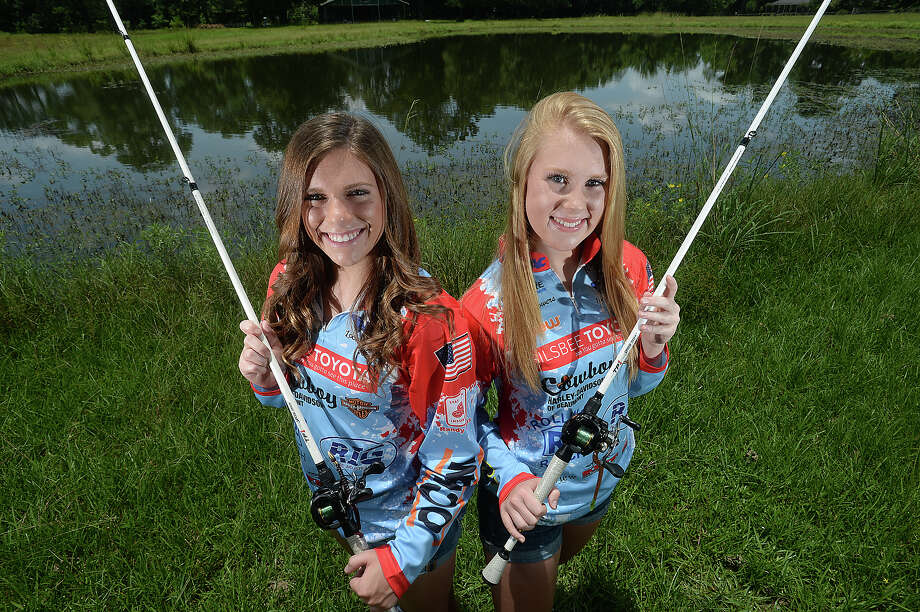Lumberton High School's Natalie Doucet and Baylee Flowers will compete in this weekend's Southeast Texas High School Fishing Association's championship tournament at Sam Rayburn. The pair are currently at the top of the leader board after being named Anglers of the Year, and stand to take home a $10,000.00 prize if they win. Like professional anglers, their uniforms are covered with sponsorships from area businesses. Several regional high schools have fishing teams, as the sport continues to rise in popularity. Photo taken Thursday, June 16, 2016 Kim Brent/The Enterprise Photo: Kim Brent / Beaumont Enterprise