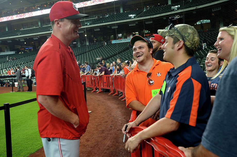 Beaumont native and West Brook High School graduate Jay Bruce stops over to talk with old classmates, including (from left) J. Bienvenu, Justin Hidalgo, and Taryn Robinson, as he and teammates with the Cincinnati Reds get ready for the opening of a three-game match-up with the Houston Astros at Minute Maid stadium Friday. Bruce was drafted into the major league straight out of high school and has been with the Reds for nearly a decade, where he is a starter playing right field. Photo taken Friday, June 17, 2016 Kim Brent/The Enterprise Photo: Kim Brent / Beaumont Enterprise