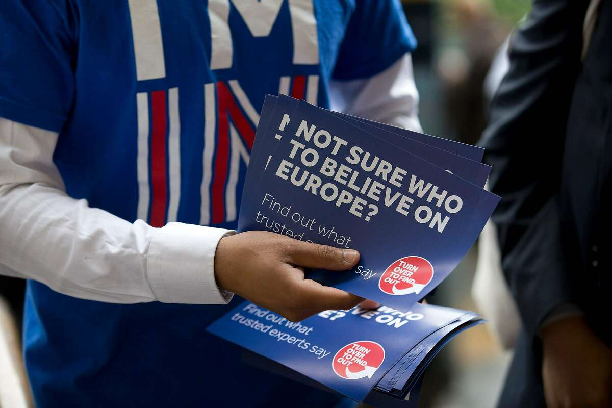 A campaigner hands out leaflets for 'Britain Stronger in Europe', the official 'Remain' campaign group seeking to avoid a Brexit outside Waterloo station, ahead of the forthcoming EU referendum in London on June 20, 2016. AFP PHOTO/JUSTIN TALLIS / AFP PHOTO / JUSTIN TALLISJUSTIN TALLIS/AFP/Getty Images