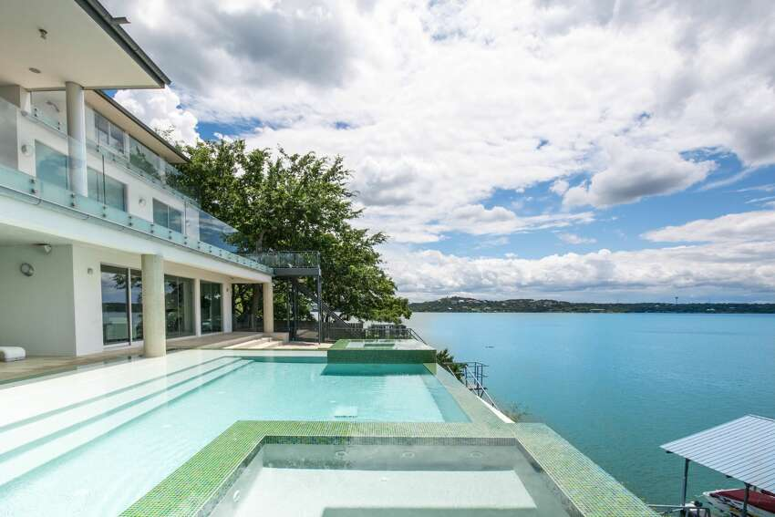 The .57-acre estate sits along the shores of Lake Travis, near the deepest part of the lake, according to its listing.