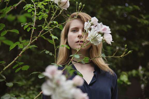 """Emma Cline's urge to understand the dark impulses that drove Mansons acolytes gave rise to her debut novel, """"The Girls."""""""