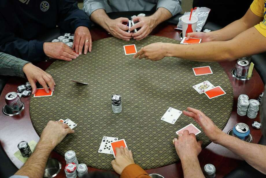 Friends of Scott Slinker play a game of poker at his office in San Jose, Calif., on April 13, 2016. Photo: James Tensuan /For The San Francisco Chronicle / James Tensuan