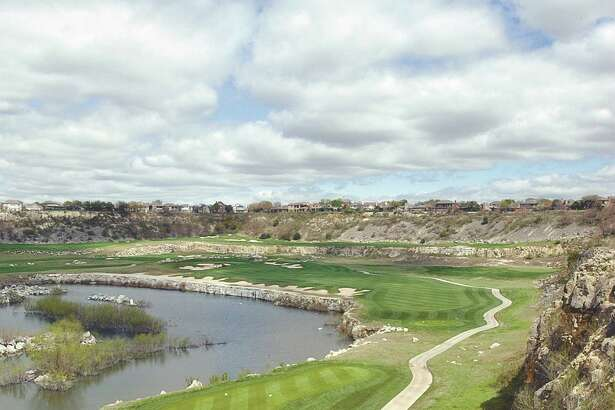 A view of the fairway of hole 13 of the Quarry Golf Club in 2002. Local developer Embrey Partners plans to replace the club's current clubhouse with an apartment complex.