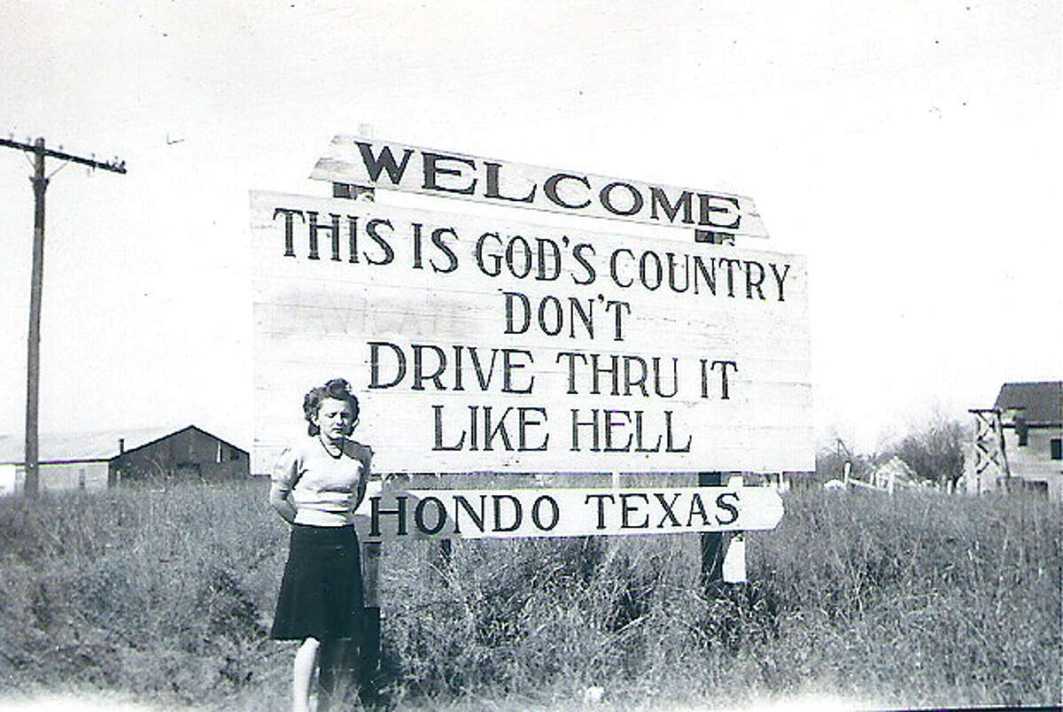 """Hondo's original """"This is God's Country, Don't Drive Thru It Like Hell"""" sign is seen in this 1944 photo."""