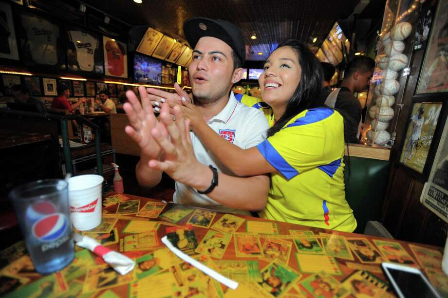 Jairo Herrera and his fiancée Talia Ordonez, both of Stamford, react to the action as they watch the U.S. play Ecuador in a Copa America quarterfinal soccer match. The couple took in the game with others at Bobby Valentines Sports Bar in Stamford, Conn., on Thursday, June 16, 2016. Photo: Matthew Brown / Hearst Connecticut Media / Stamford Advocate