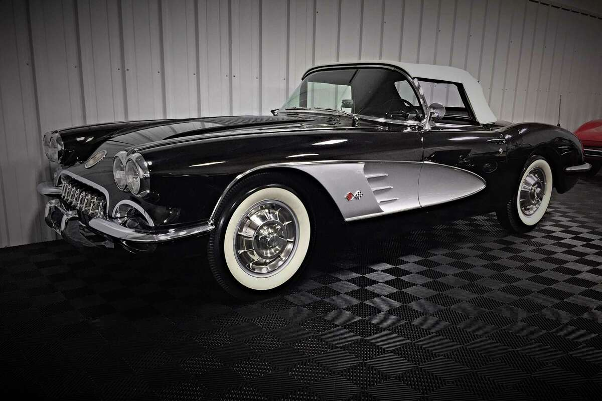 1958 CHEVROLET CORVETTE CONVERTIBLE-Features the correct 283ci engine with a 4-barrel carburetor and 4-speed transmission. 1958 Corvettes have the unique, one-year-only lowered hood and trunk spears.