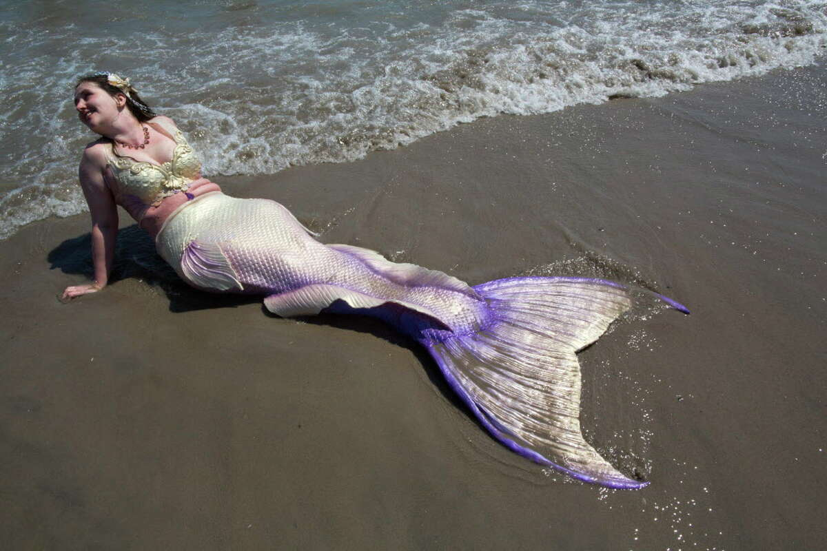 Heather Schroeder cools off in the ocean after marching in the 34th Annual Mermaid Parade, Saturday, June 18, 2016, in New York's Coney Island. (AP Photo/Mary Altaffer) ORG XMIT: NYMA104