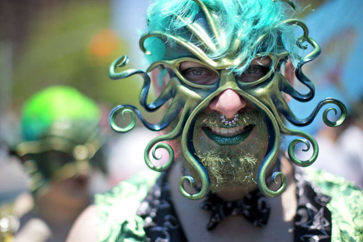 A participant poses for a photo in the staging area before marching in the 34th Annual Mermaid Parade, Saturday, June 18, 2016, in New York's Coney Island. (AP Photo/Mary Altaffer) ORG XMIT: NYMA109