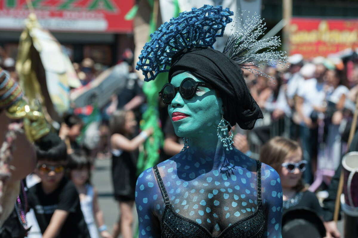 NEW YORK, NY - JUNE 18 : People participate in Coney Island's annual Mermaid Parade on June 18, 2016 in the Brooklyn borough of New York City. The 34th annual parade celebrates mythology, artistic spirit and seaside culture. (Photo by Stephanie Keith/Getty Images) ORG XMIT: 640938211