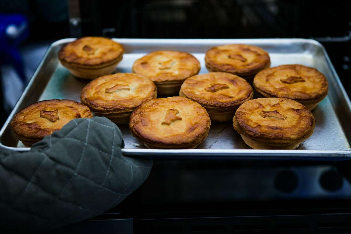 Owner and chef Nick Lee pulls savoy pies out of the oven, at the Sage Bakehouse pie stand at the Clement Street Market, in San Francisco, California, on Sunday, June 19, 2016.