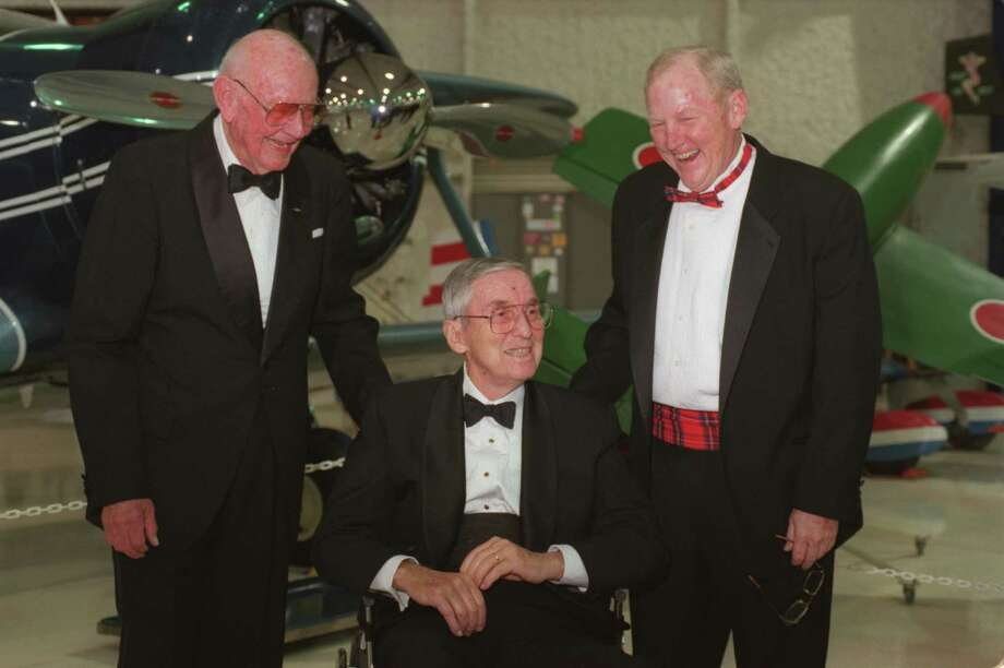 David 'Tex' Hill, left, and Lloyd Bentsen, center, both inductees to the Texas Aviation Hall of Fame share a laugh with Ralph Royce, right,  president of Lone Star Flight Museum, during a reception at the induction gala in November 1999. (Melissa Phillip/Chronicle) Photo: Melissa Phillip, Staff / Houston Chronicle