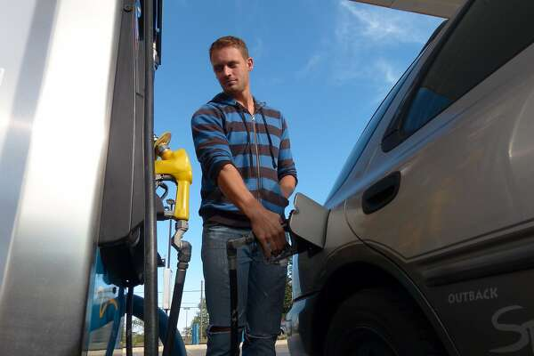 UTSA student Michael Gomm takes advantage of low gas prices at the Valero Station at 5602 UTSA Blvd on Friday, Oct. 31, 2014.