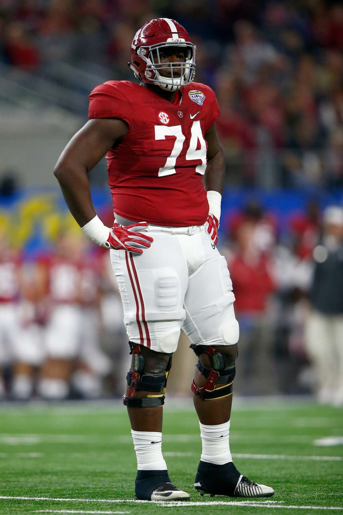ARLINGTON, TX - DECEMBER 31: Cam Robinson #74 of the Alabama Crimson Tide looks on against the Michigan State Spartans during the Goodyear Cotton Bowl at AT&T Stadium on December 31, 2015 in Arlington, Texas. (Photo by Jamie Squire/Getty Images)