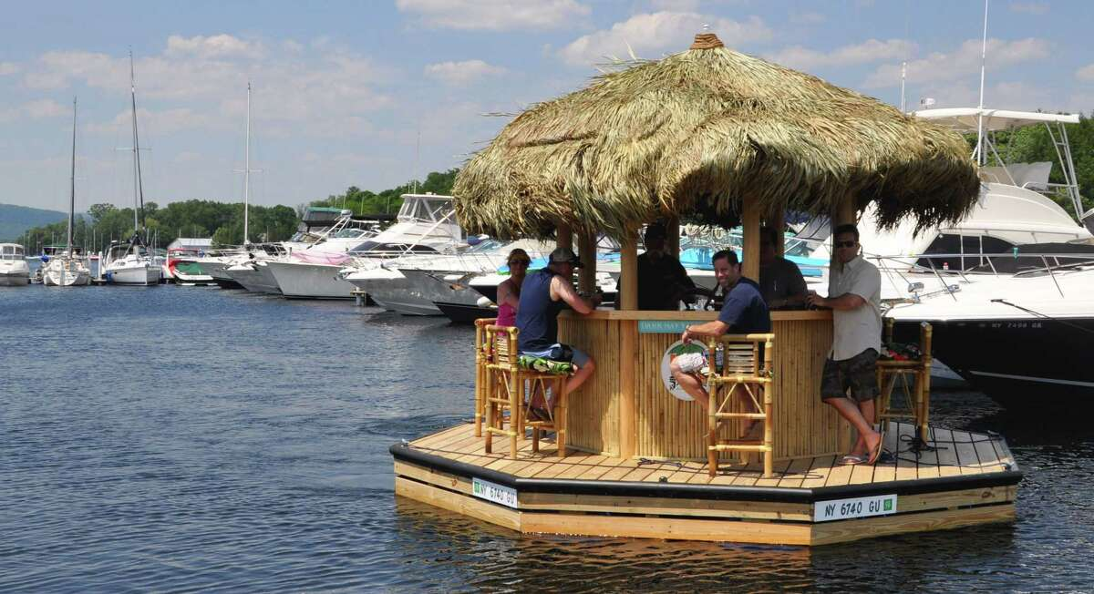 A new tiki bar boat launches at the Harris Bay Yacht Club on Monday, June 20, 2016 in Lake George, N.Y. (Eliza Mineaux/Special to the Times Union)