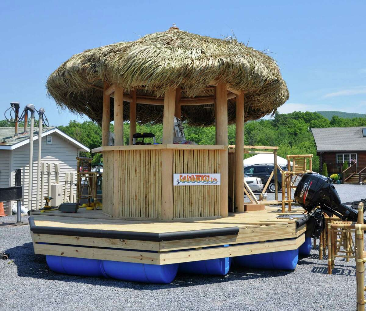 A new tiki bar boat getting ready to be launched at the Harris Bay Yacht Club on Monday, June 20, 2016 in Lake George, N.Y. (Eliza Mineaux/Special to the Times Union)