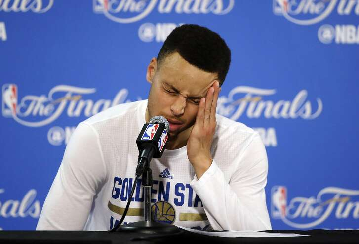 Golden State Warriors' Stephen Curry answers questions during a post-game news conference after Game 7 of basketball's NBA Finals on Sunday, June 19, 2016, in Oakland, Calif. Cleveland won 93-89. (AP Photo/Eric Risberg)