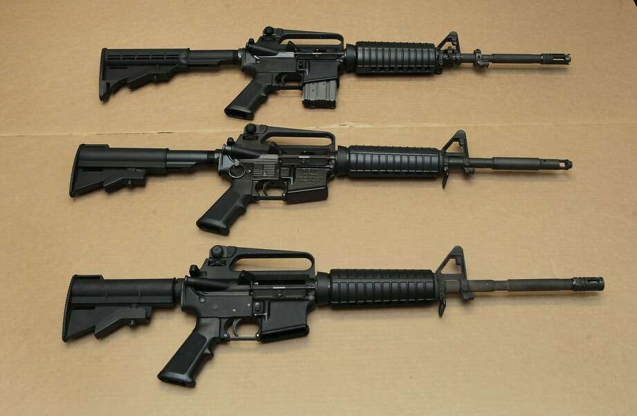 Three variations of the AR-15 assault rifle are displayed at the California Department of Justice in Sacramento in 2012. Photo: Rich Pedroncelli, Associated Press