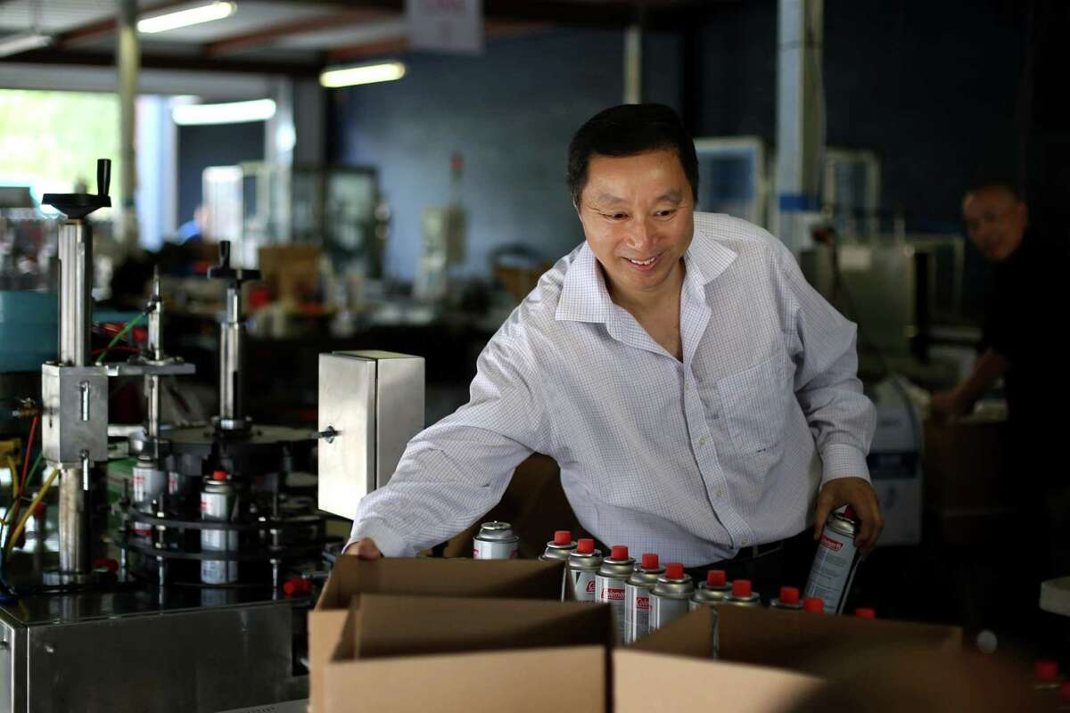CEO Jude Shao fills orders of butane canisters at Sky Blue Butane in southeast Houston. Shao endured a decade in a Chinese prison after refusing to pay a bribe and to cooperate with authorities who accused him of tax evasion.