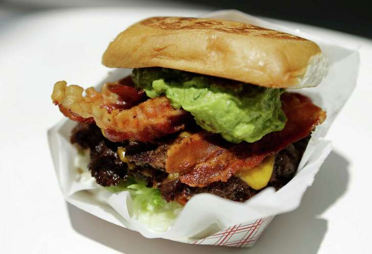 A double cheddar cheese burger with bacon and guacamole from Kuma Burgers in the food court at 3 Greeway Plaza is shown Thursday, June 9, 2016, in Houston.  ( Melissa Phillip / Houston Chronicle )