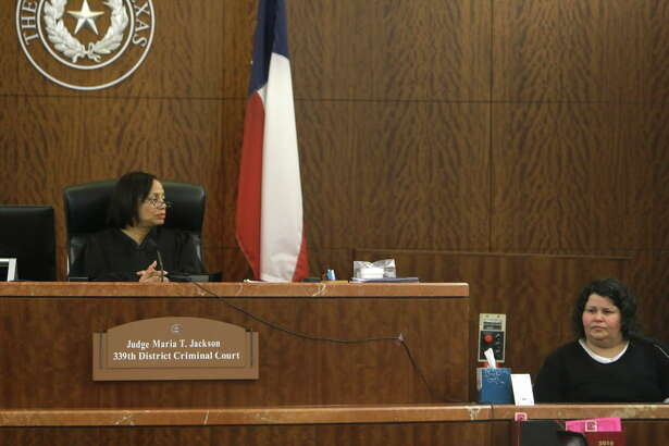 Judge Maria T. Jackson of the 339th District Criminal Court listens as Kimberly Nicole Cormier, 41, right, testifying during her capital murder trial Monday, June 20, 2016, in Houston.